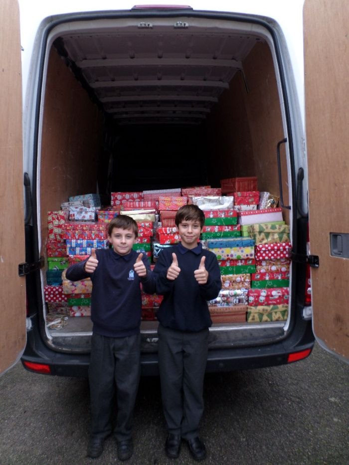 Boys with the van collecting our love in a boxes