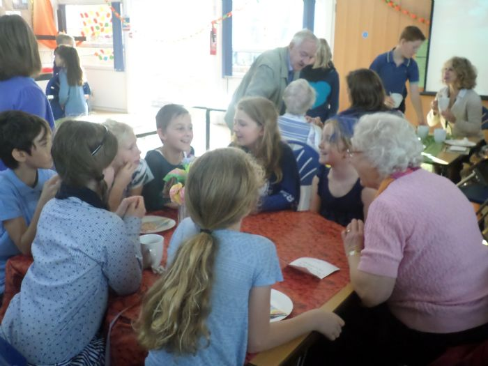 Children and guest enjoying a conversation together